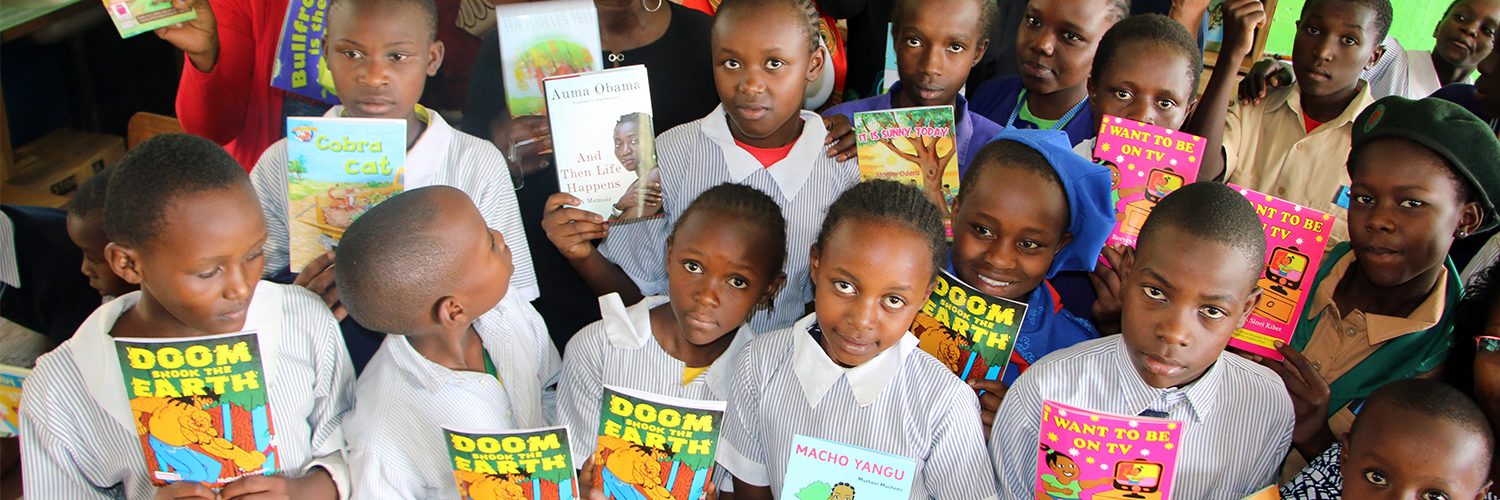 Children, partners and SAL celebrate new books for Martin Luther Primary School